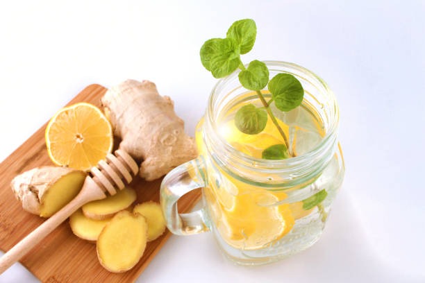 Glass of water, lemon, mint and ginger as background. Detox. stock photo