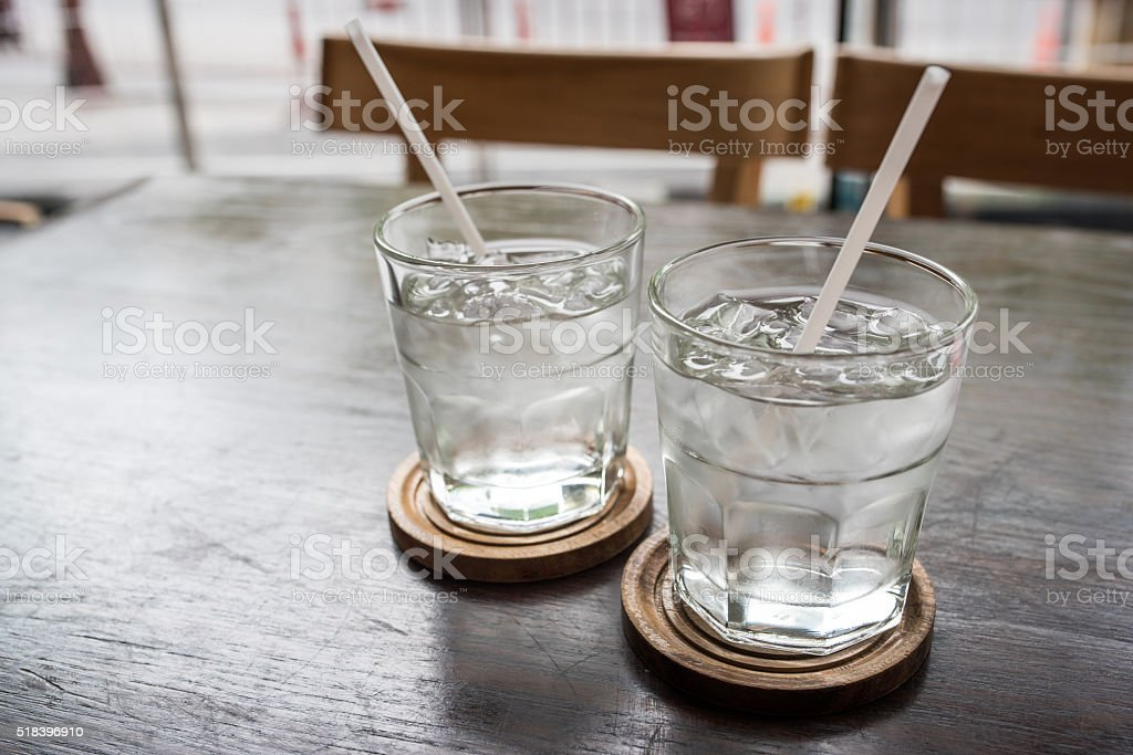 glass of water on a table in a restaurant stock photo