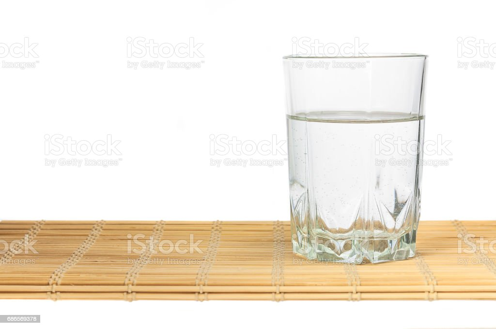 A glass of water on bamboo Mat royalty-free stock photo