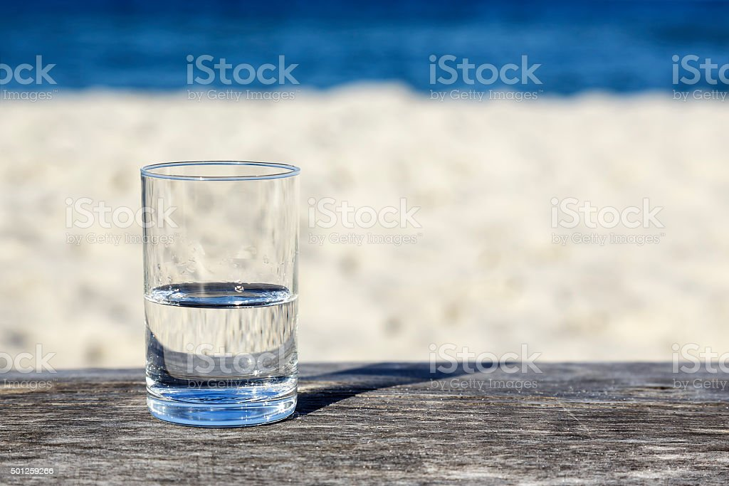 Glass of water which is half-full stock photo