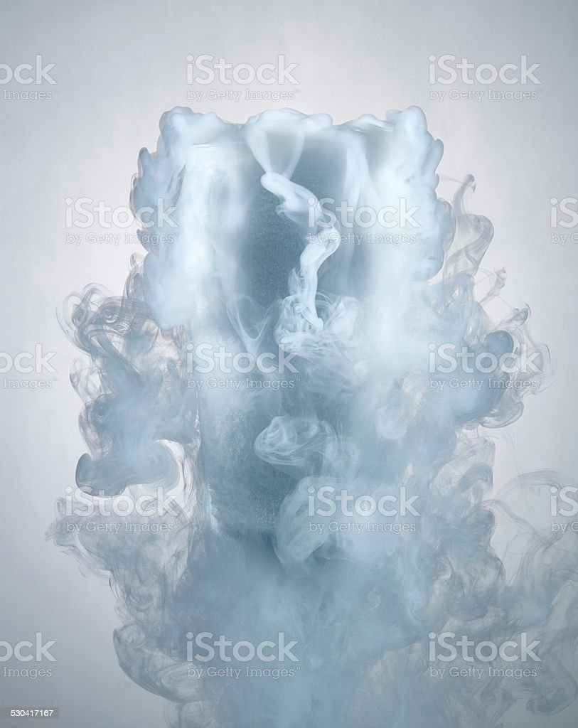 glass of water with dry ice vapor stock photo