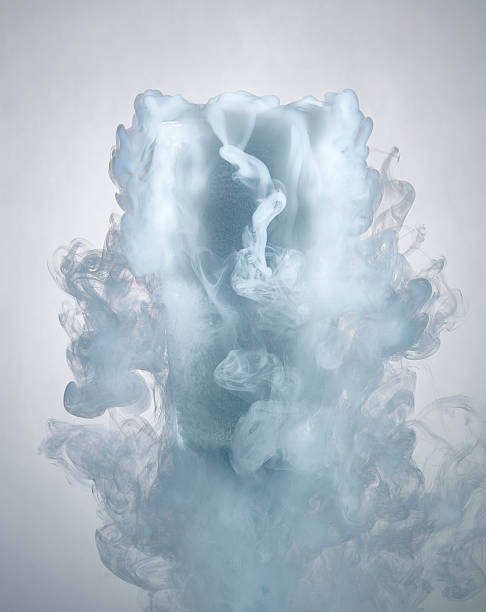 glass of water with dry ice vapor glass of water with dry ice vapor chemical reaction stock pictures, royalty-free photos & images