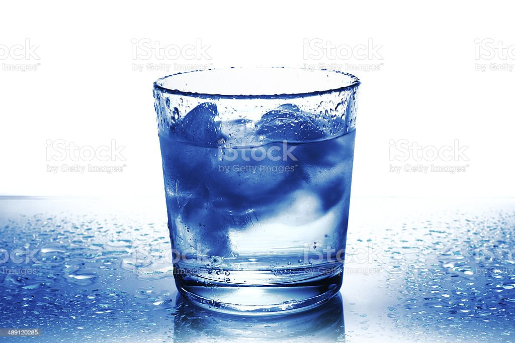 Glass of water with ice stock photo