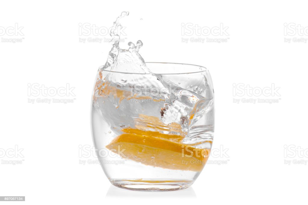 Glass of water with lemon isolated stock photo