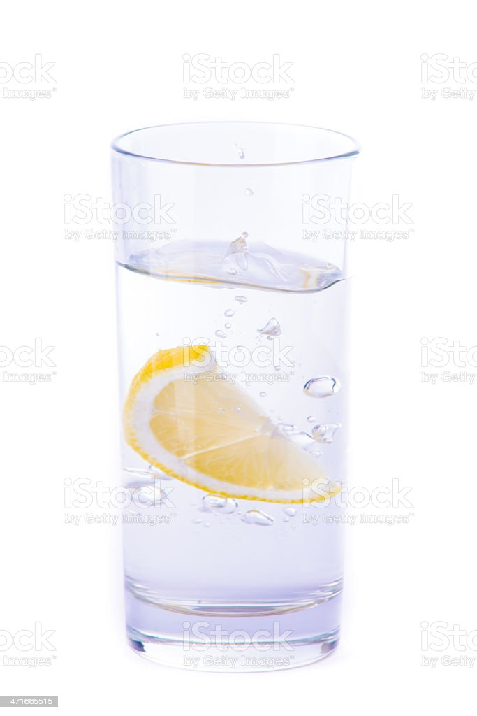Glass of water with lemon royalty-free stock photo