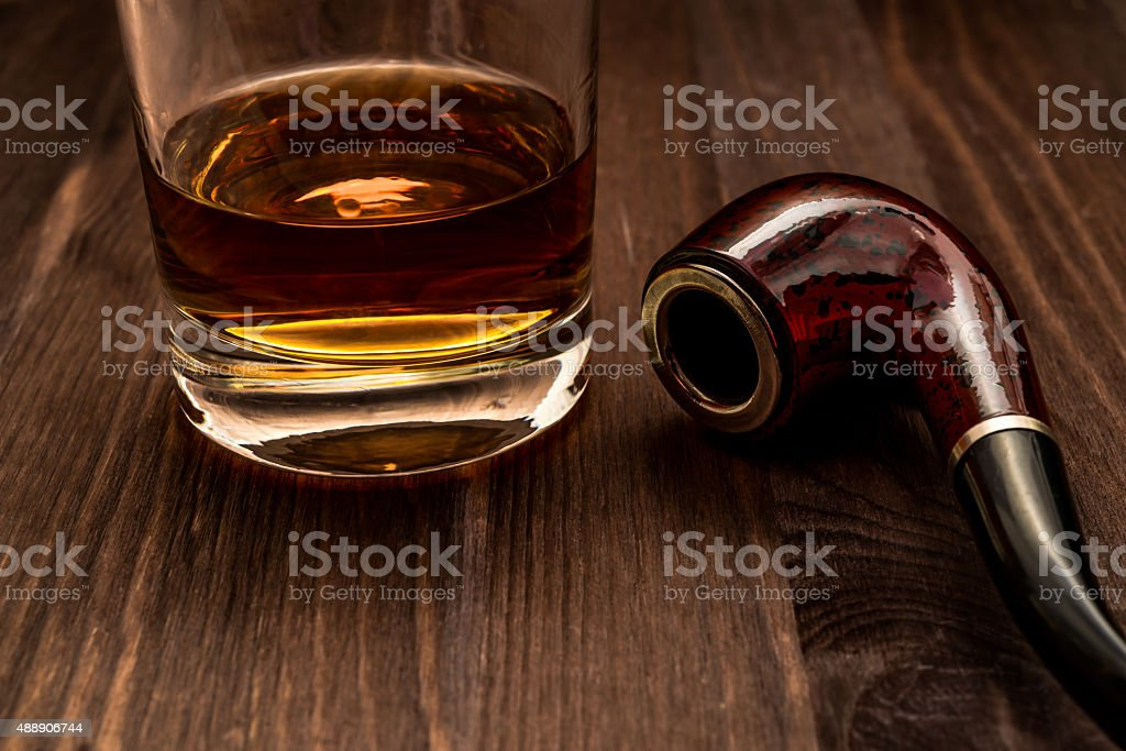 Glass Of Whiskey And Tobacco Pipe Stock Photo - Download Image Now