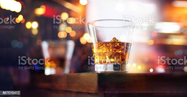 Glass of whiskey drink with ice cube on table wooden bar background picture id857015412?b=1&k=6&m=857015412&s=612x612&h=l6z2bunuznin15lemctf9eeyx  5ymqp4n7rxi 6ooa=