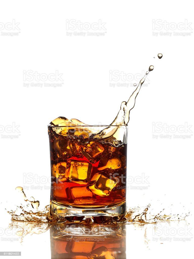 Glass of whiskey, ice cubes. stock photo