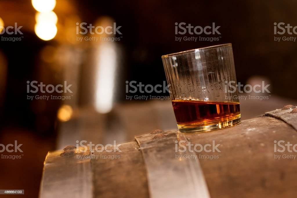 Glass of whiskey in distillery stock photo
