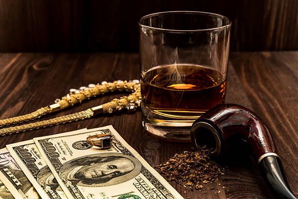 Glass Of Whiskey With A Jewellery And Tobacco Pipe Stock Photo