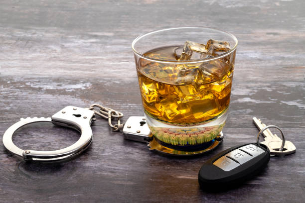 Glass of whiskey with a set of car keys stock photo