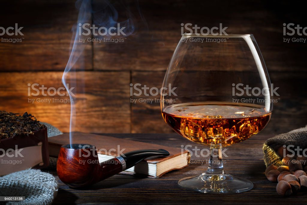 Glass Of Whiskey With Ice Notebook And Smoking Pipe Stock Photo