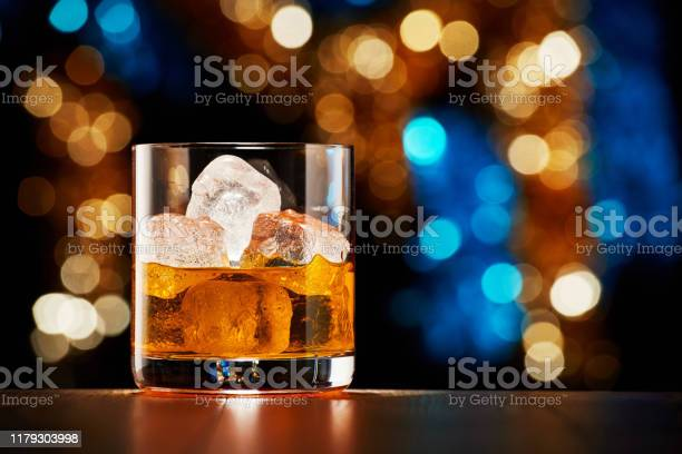 Glass of whiskey with ice on colorful christmas lights bokeh picture id1179303998?b=1&k=6&m=1179303998&s=612x612&h=oi94knk0s5cssrcosqwi4ugjpq1osndwx th81clfoa=