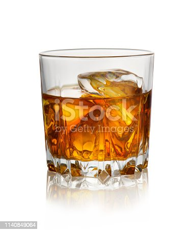 Glass of whiskey with ice isolated on a white background