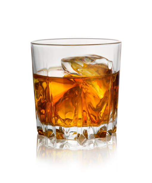 Glass of whiskey with ice Glass of whiskey with ice isolated on a white background drinking glass stock pictures, royalty-free photos & images