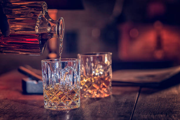 glass of whiskey with ice - whiskey stock photos and pictures