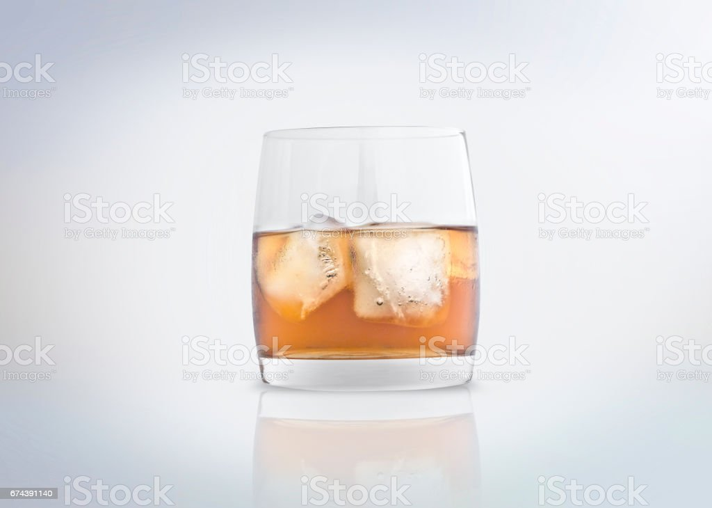 Glass of whisky with ice stock photo