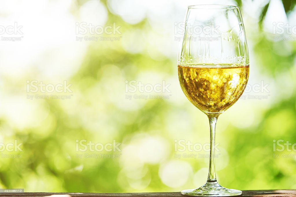 Glass of white whine stock photo