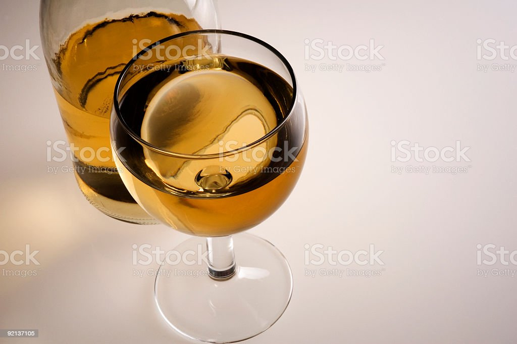 Glass of white wine and bottle royalty-free stock photo