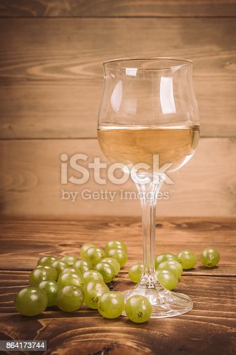 Glass Of White Wine And Grapes On Rustic Wood Table Stock Photo & More Pictures of Aging Process