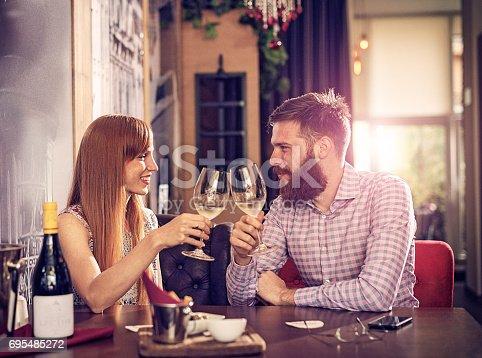 istock Glass of white wine before dinner 695485272