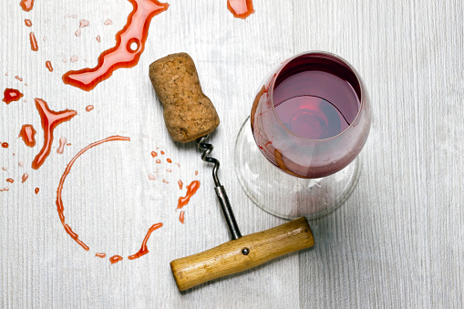 glass of wine and a corkscrew