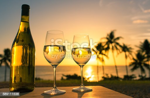 873264516istockphoto Glass of wine and beautiful view 589111538