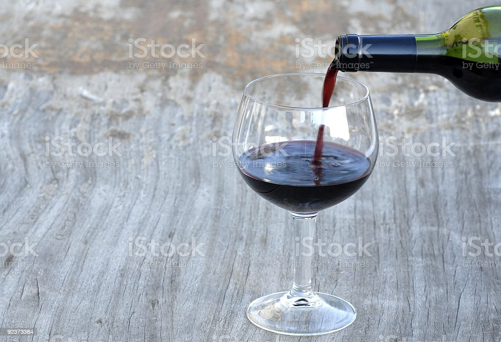 Glass of wine and bottle royalty-free stock photo