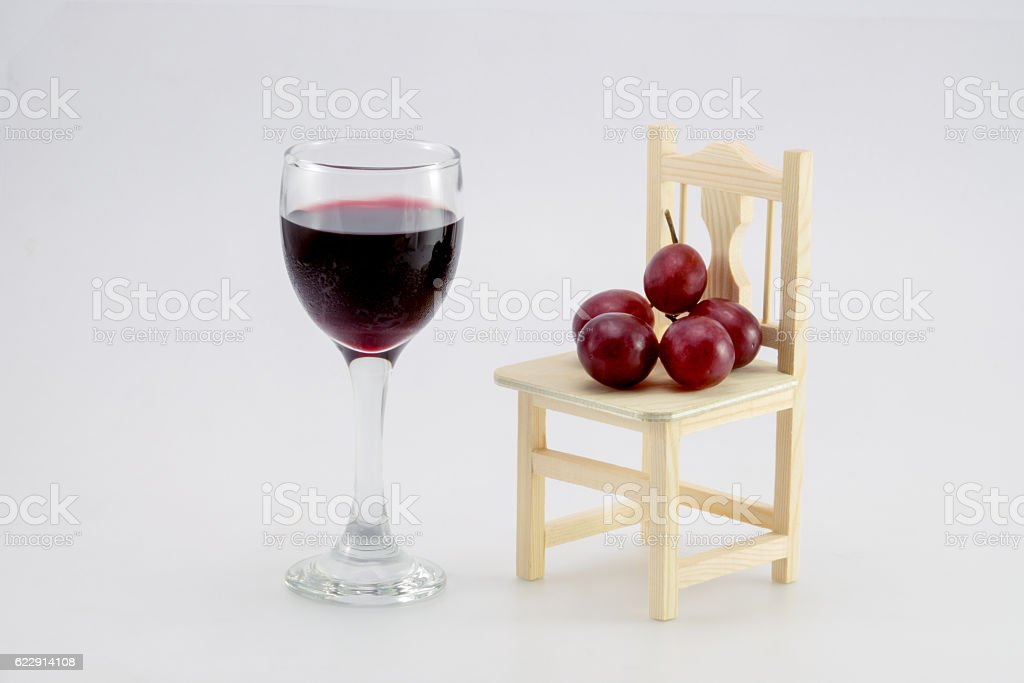 glass of wine and grapes, isolated on white stock photo