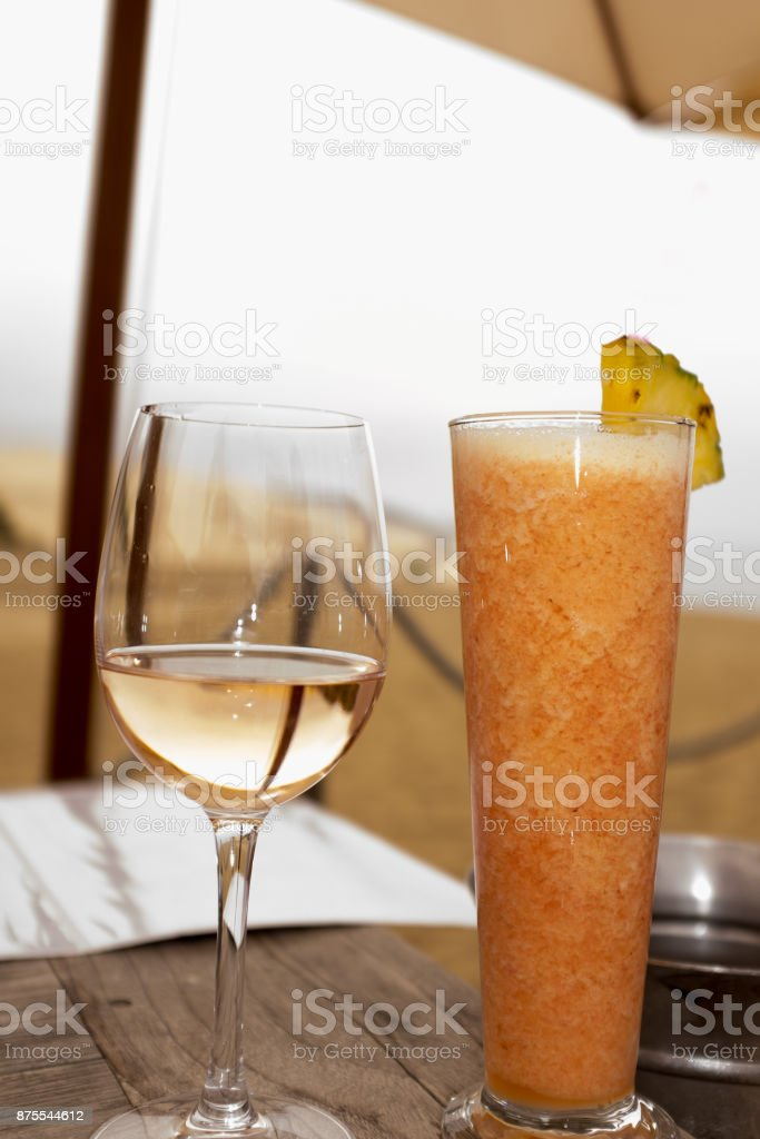 Glass of wine and Strawberry cocktail at the restaurant stock photo