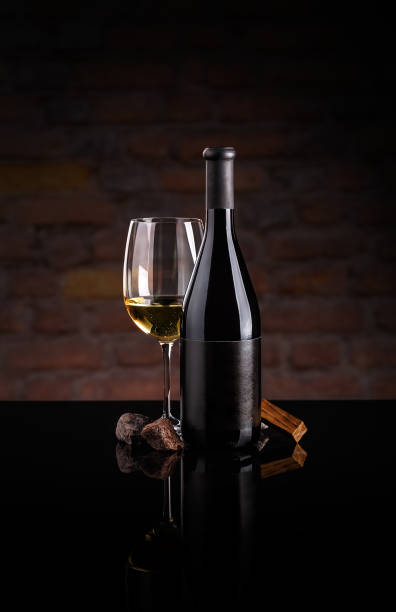 Glass of wine and wine bottle. stock photo