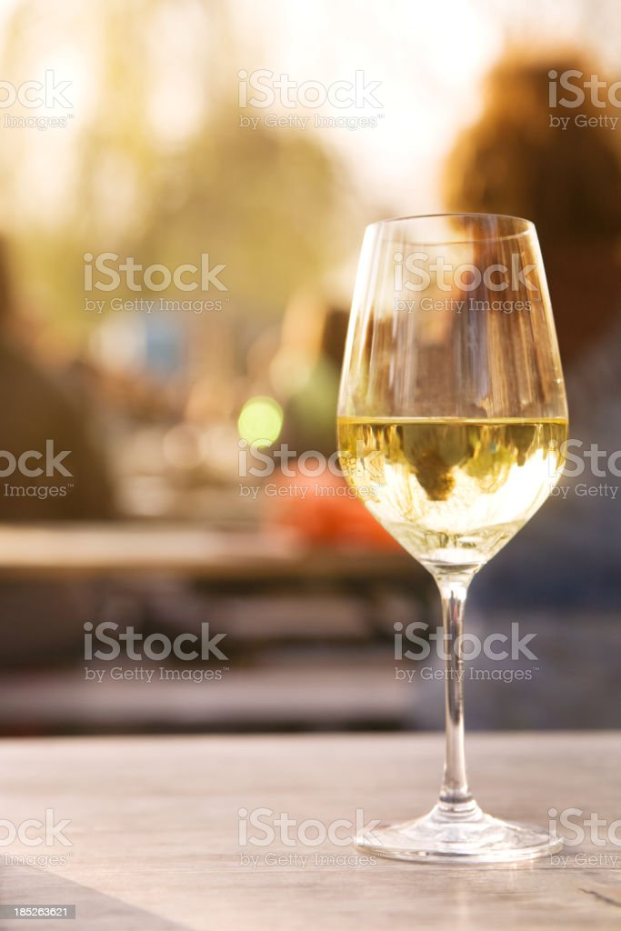Glass of wine in a sidewalk cafe royalty-free stock photo