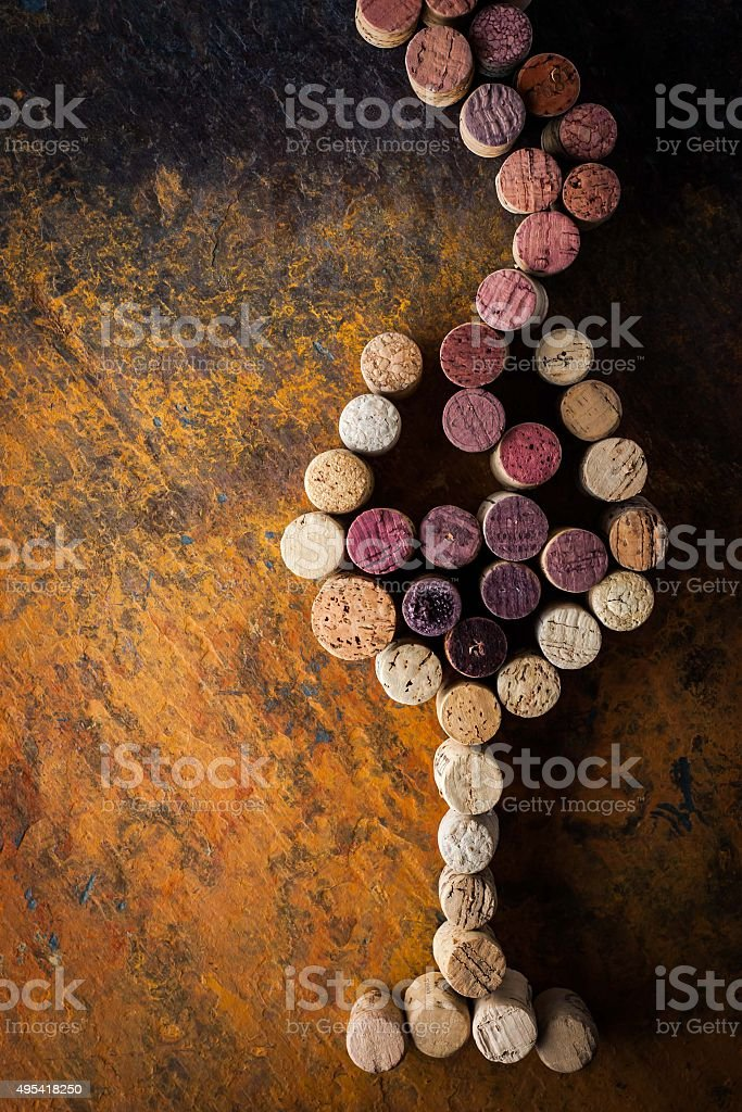 Glass of wine made by cork on the colorful background stock photo