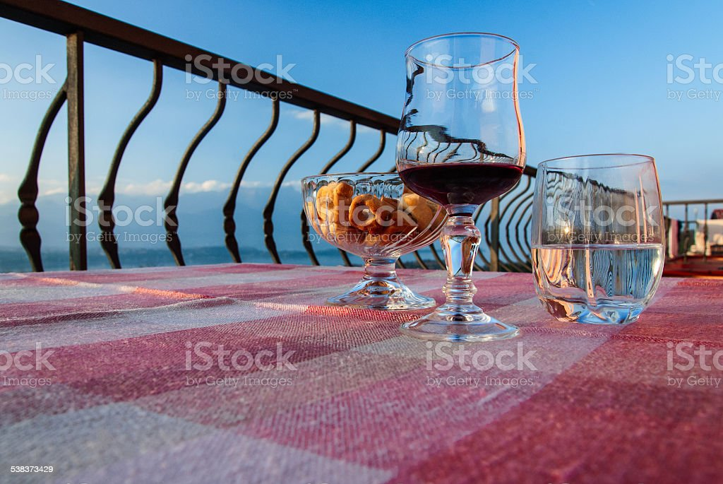 Glass of wine on the balcony stock photo