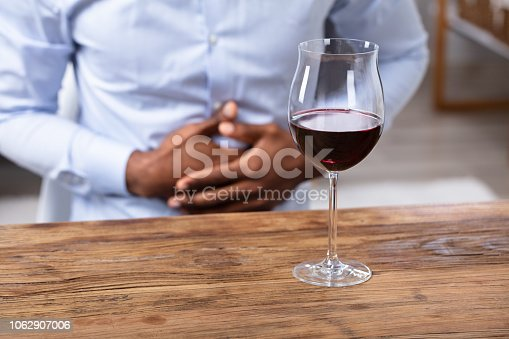 istock Glass Of Wine On Wooden Desk 1062907006