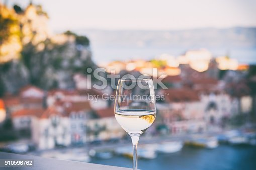 istock Glass of wine with Omis Riviera view, relax seascape background, Croatia 910596762