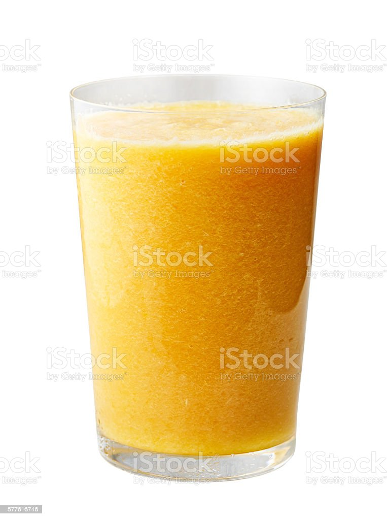 glass of yellow smoothie stock photo