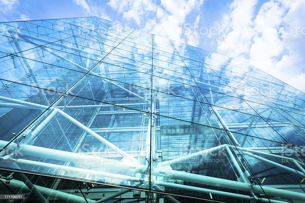 Glass Office Building and Clouds Reflections stock photo