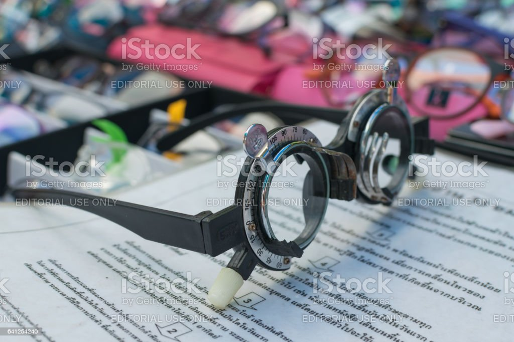 Glass optometry test and many types of glasses at glasses shop in market. stock photo
