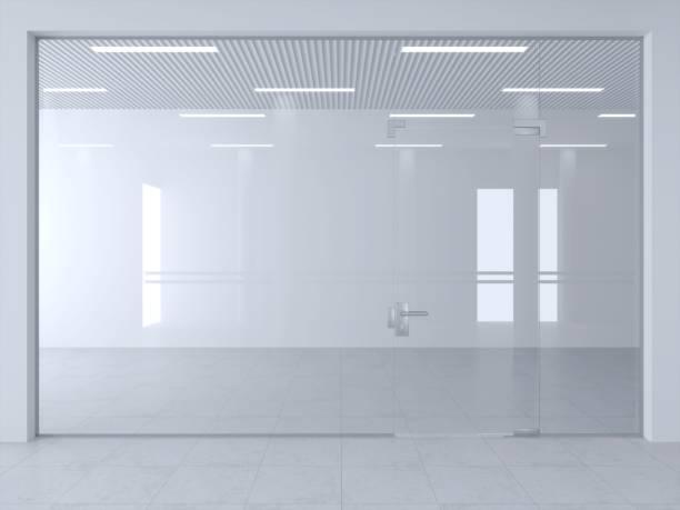 glass partition and doors in hall - стекло стоковые фото и изображения