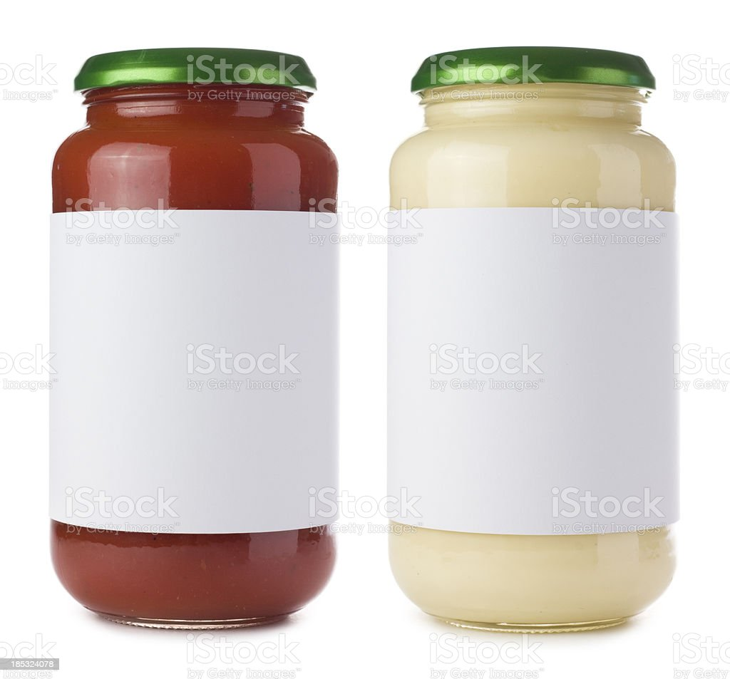 Glass pasta sauce jars on a white background royalty-free stock photo