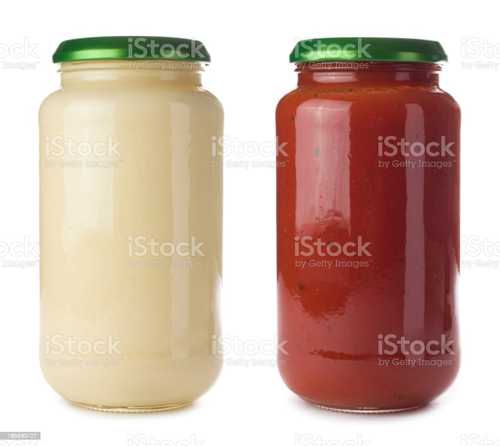 Glass pasta sauce jars on a white background stock photo