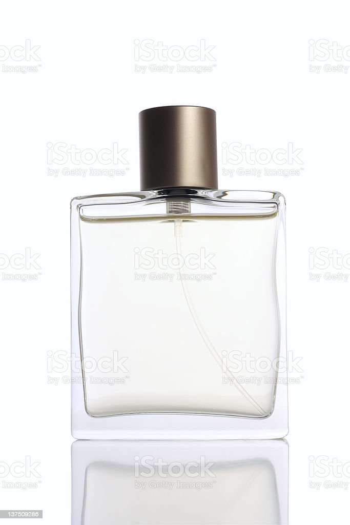 A glass perfume bottle with a brass lid stock photo