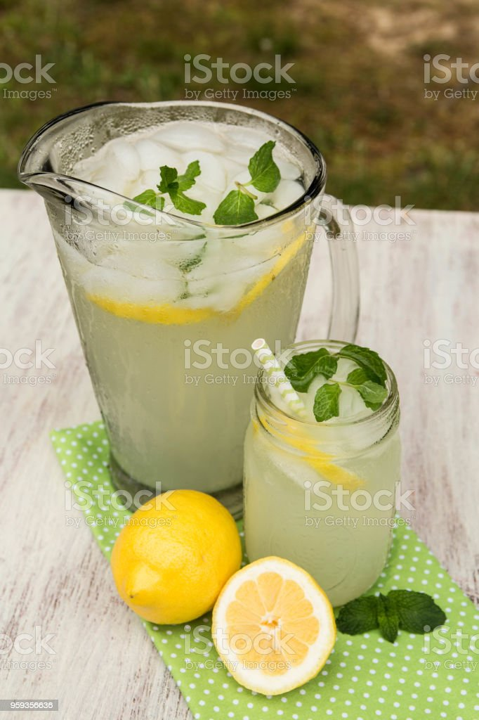 Glass Pitcher and Mug of Lemonade From Above stock photo