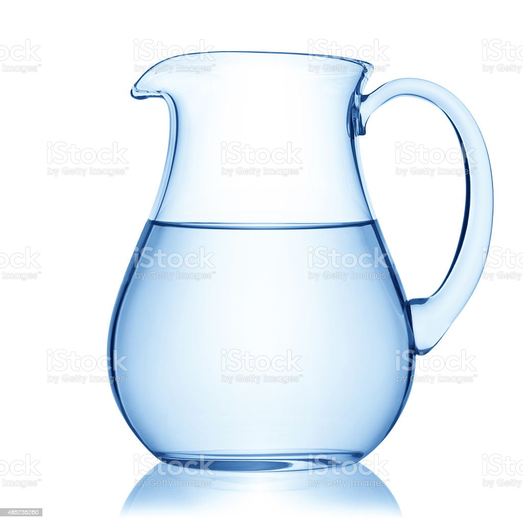 Glass pitcher of water. stock photo
