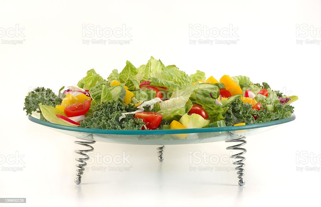 Glass plate full with vegetables . Healthy salad mix. royalty-free stock photo