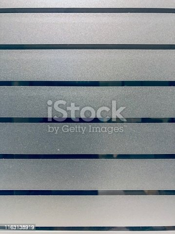 A glass plate with matt stripes as texture or background