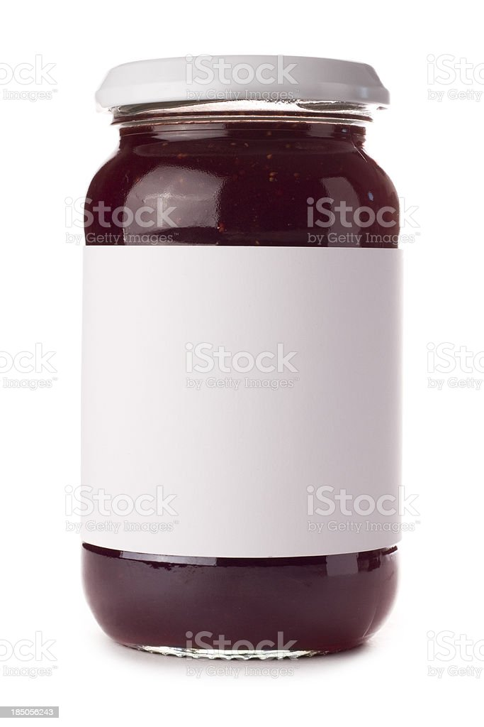 Glass preserve jar with blank label on a white background stock photo