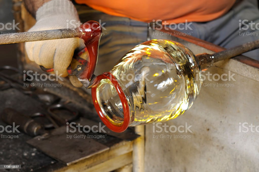 Glasss production. Cutting hot glass. Red areas approx 900 degrees...