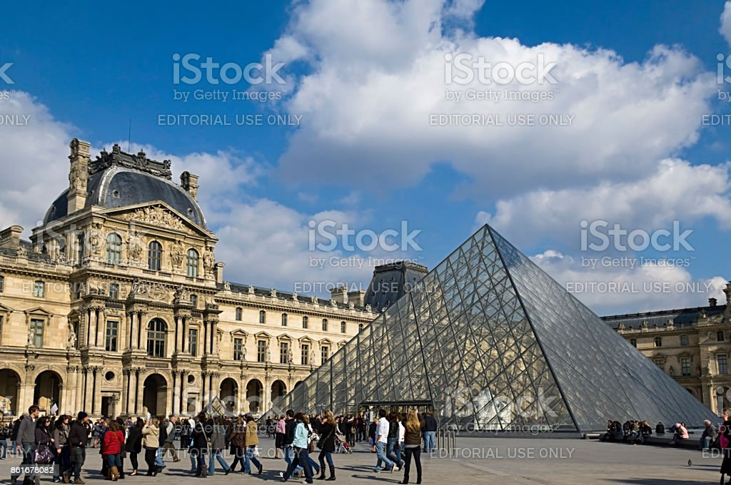 glass pyramid before the louvre museum stock photo